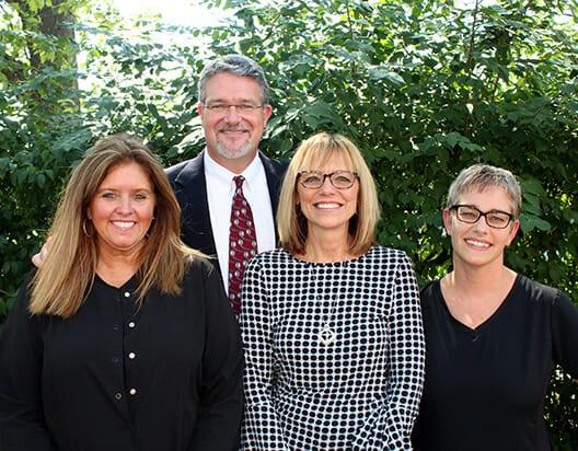 Dr. TJ Miller II and front desk team, Tami, Donna, Johanna